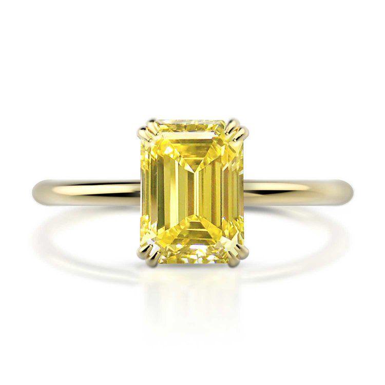 Emerald cut yellow diamond engagement ring