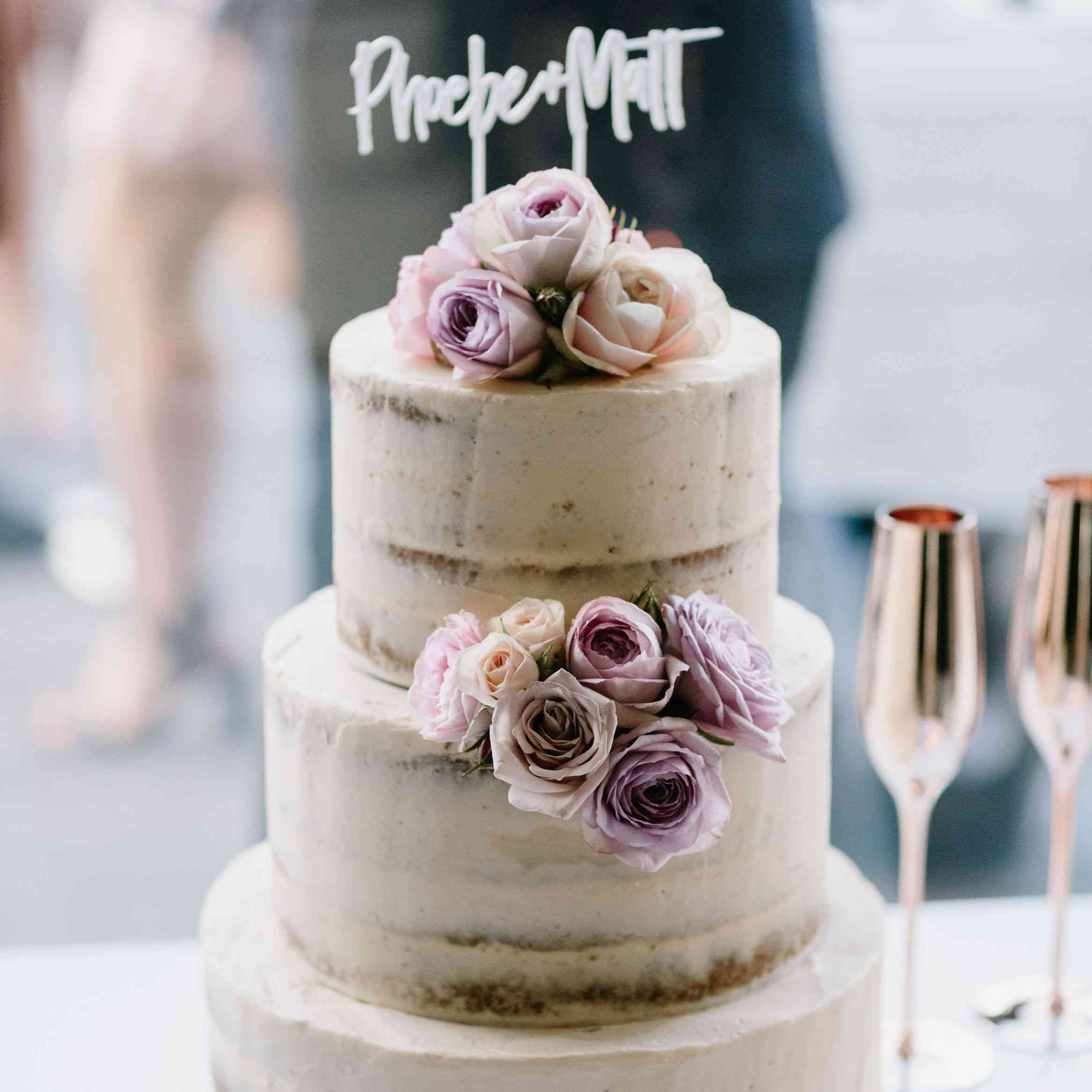 Naked cake with purple florals