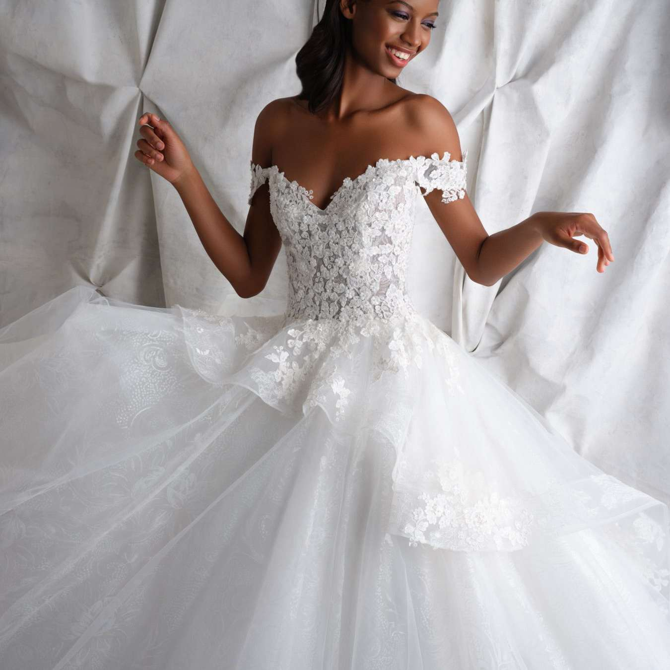 Model in off-the-shoulder gown with floral lace bodice and tulle skirt