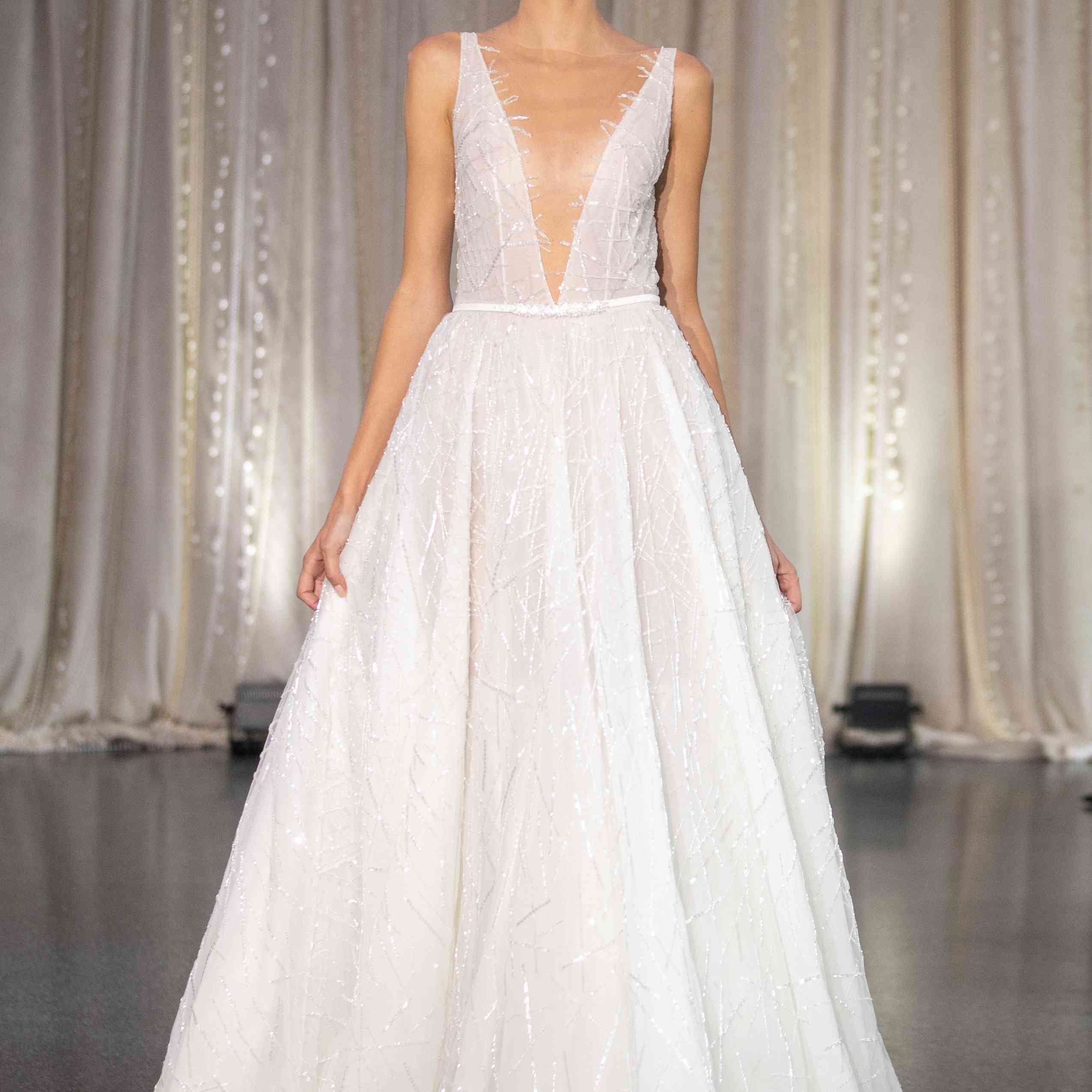 Model in sleeveless plunging wedding dress