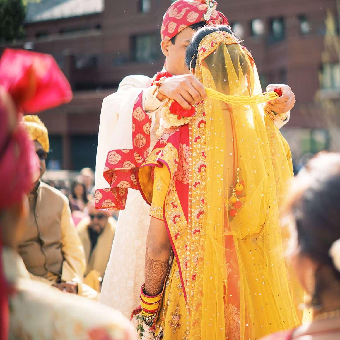 groom taking off veil