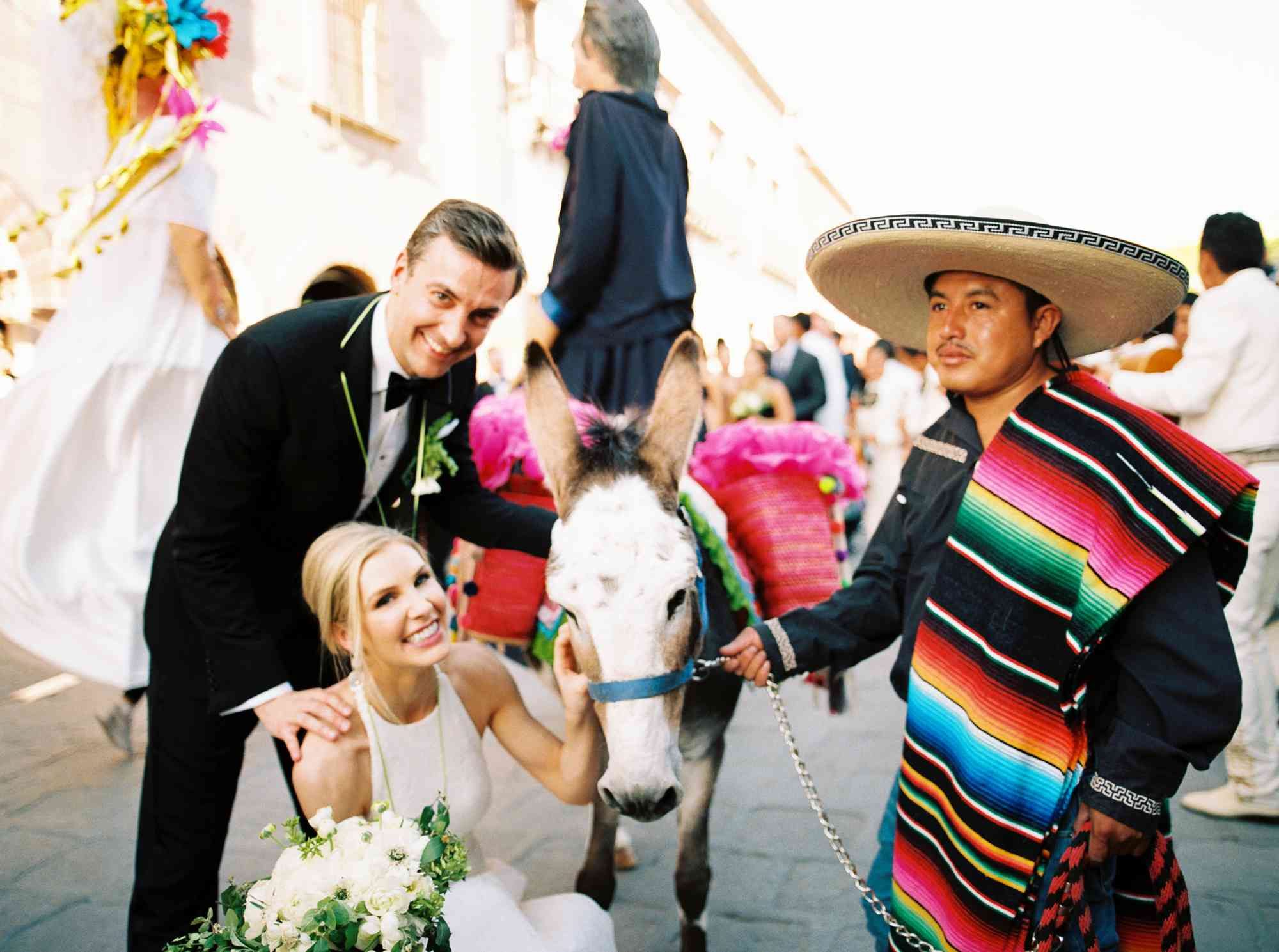 Bride and groom with a donkey