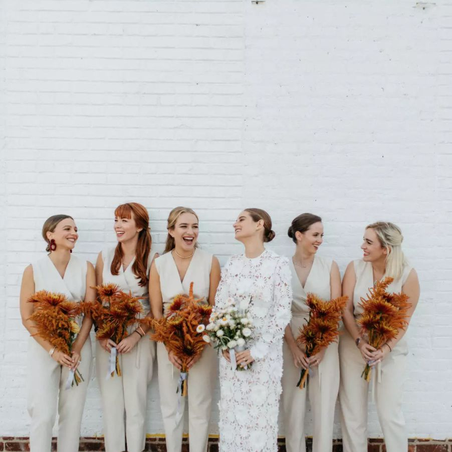 Bride with bridesmaids in beige jumpsuits