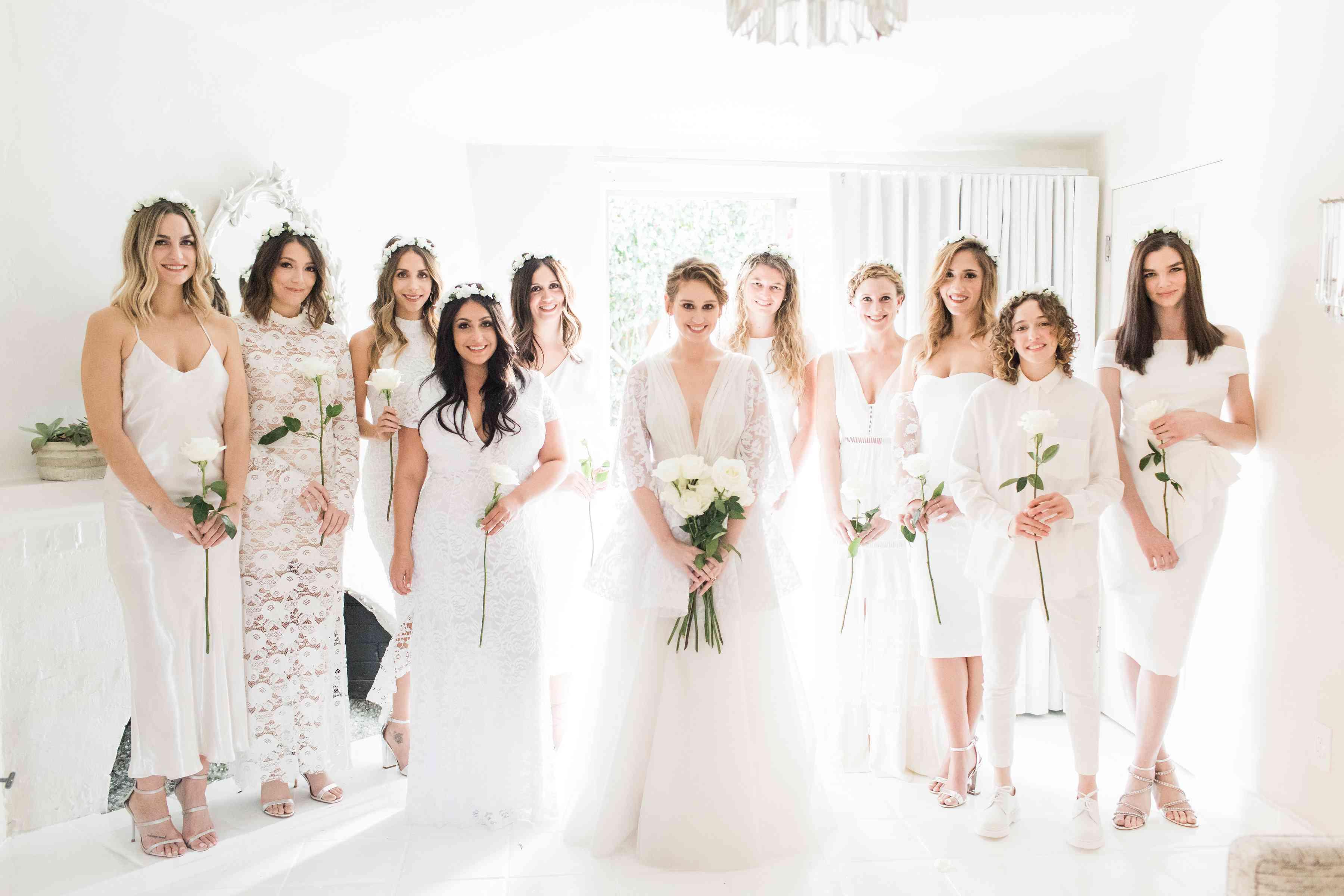 <p>bridesmaids in mismatched white dresses</p><br><br>