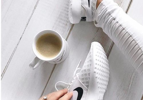 Engagement ring and coffee cup