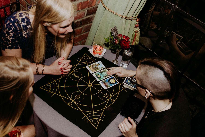 Guests having tarot cards read