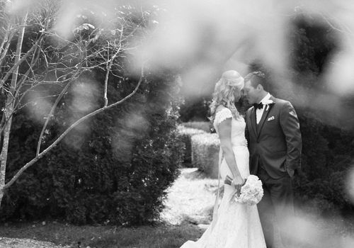 black and white photo of a couple embracing each other on their wedding day