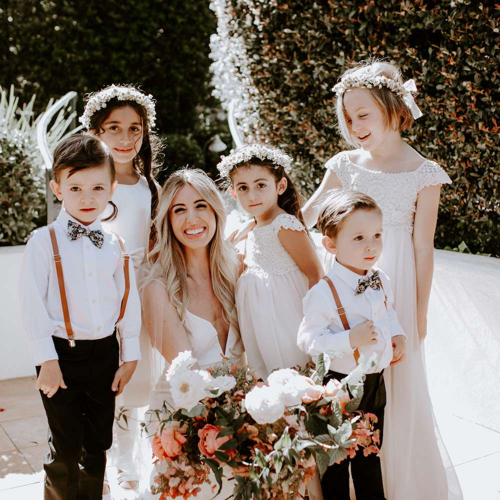 bride with flowergirls and ring bearers
