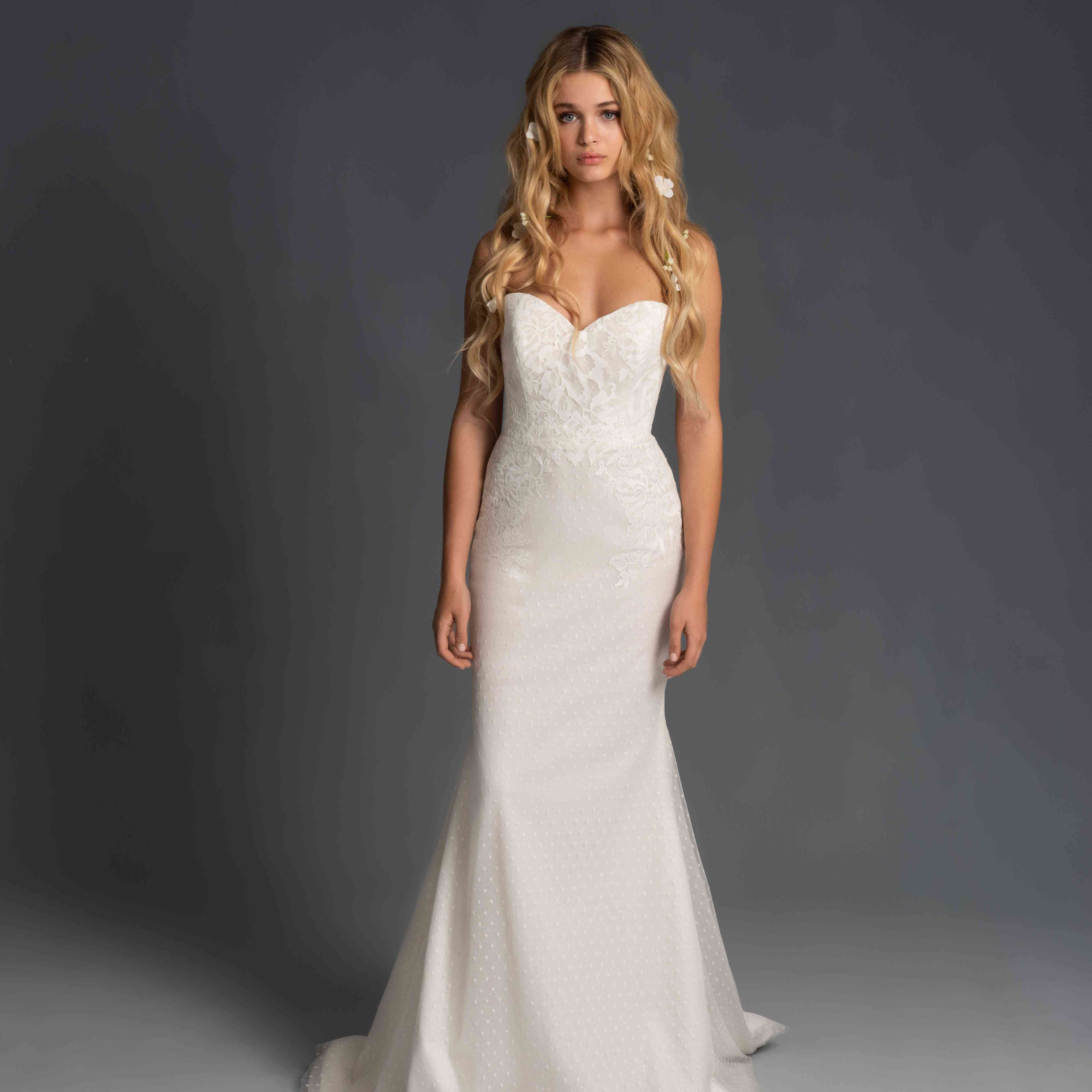 Model in strapless fit-and-flare wedding dress
