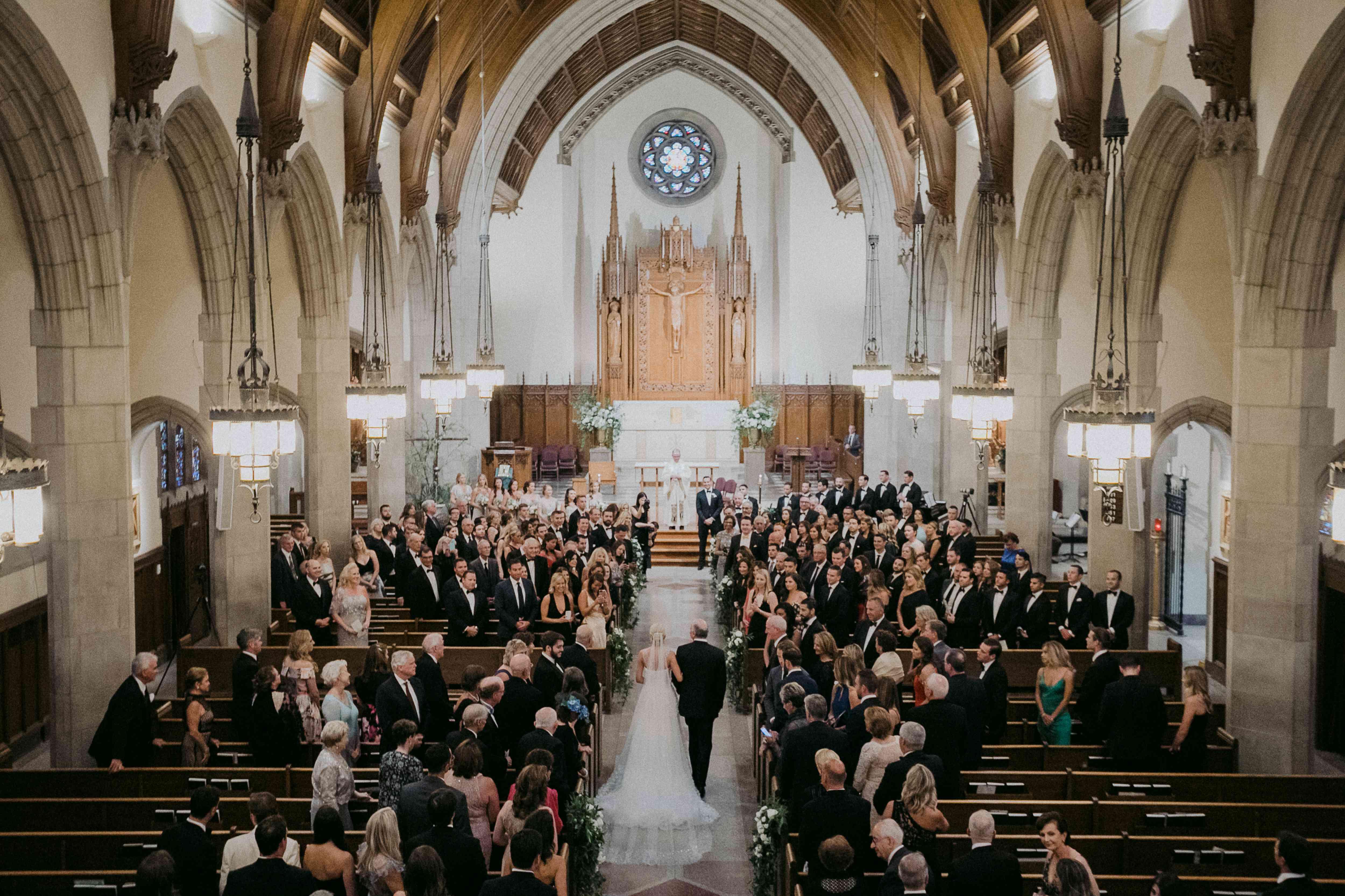 <p>Bride walking down aisle in church</p><br><br>