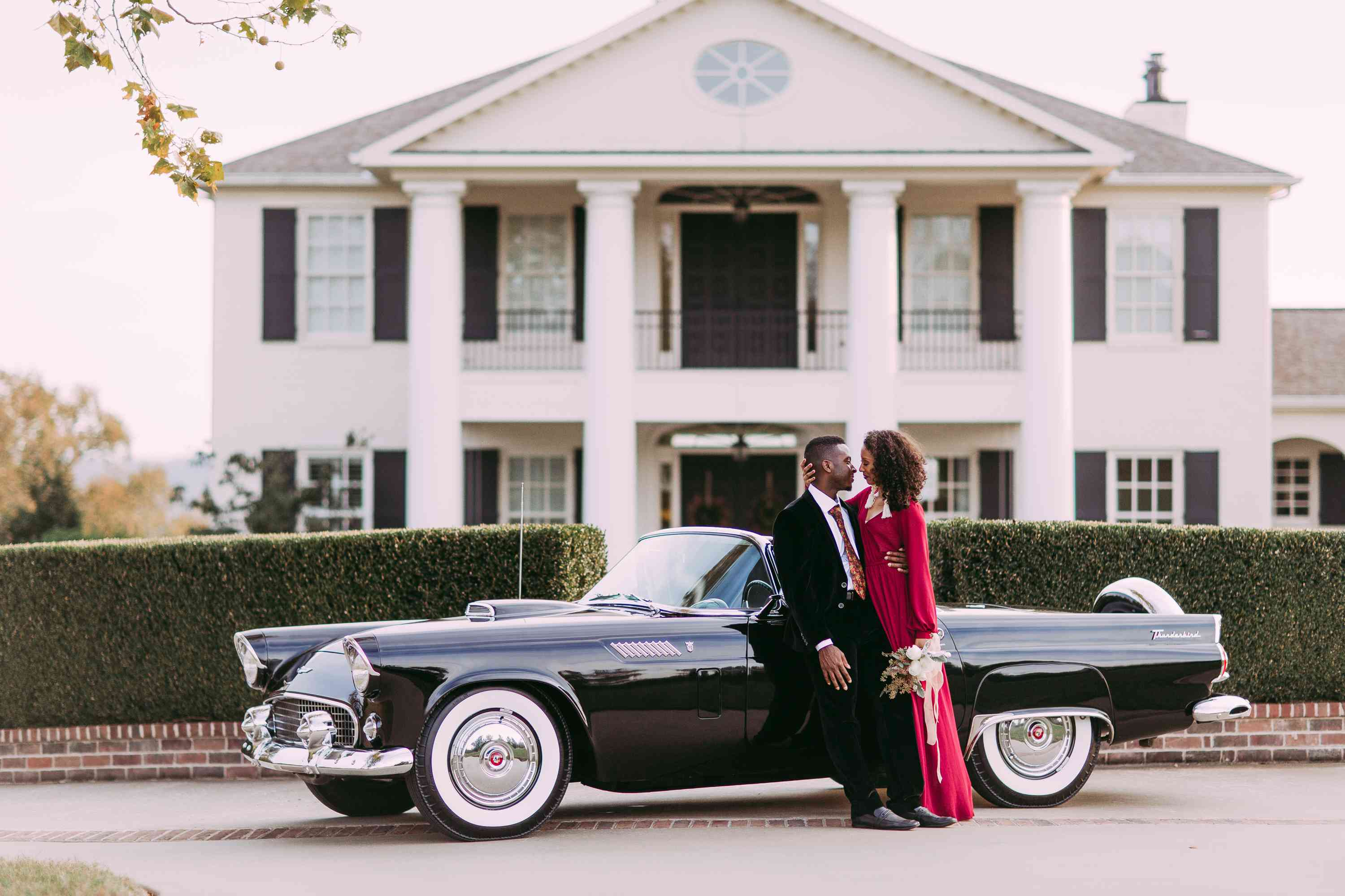 Couple in front of Thunderbird car