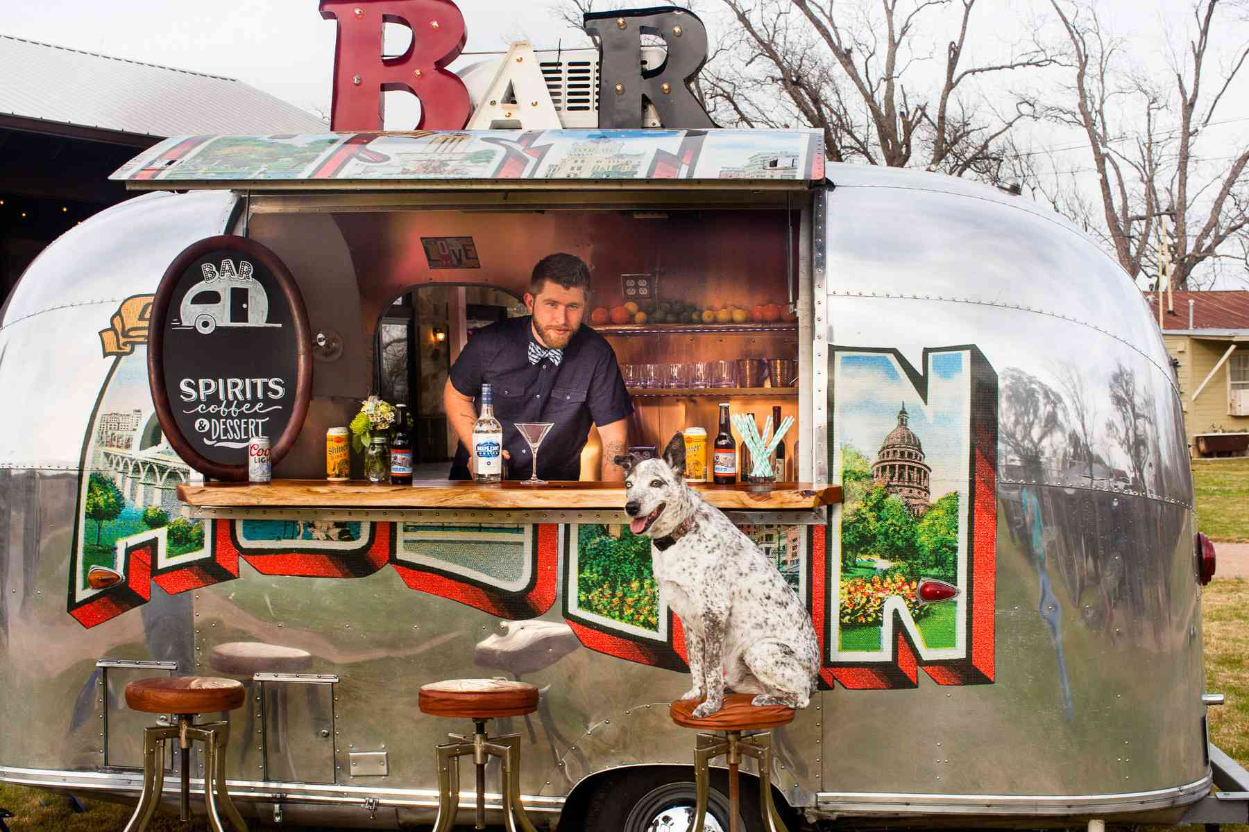 Mobile bar with bartender and dog at a wedding reception
