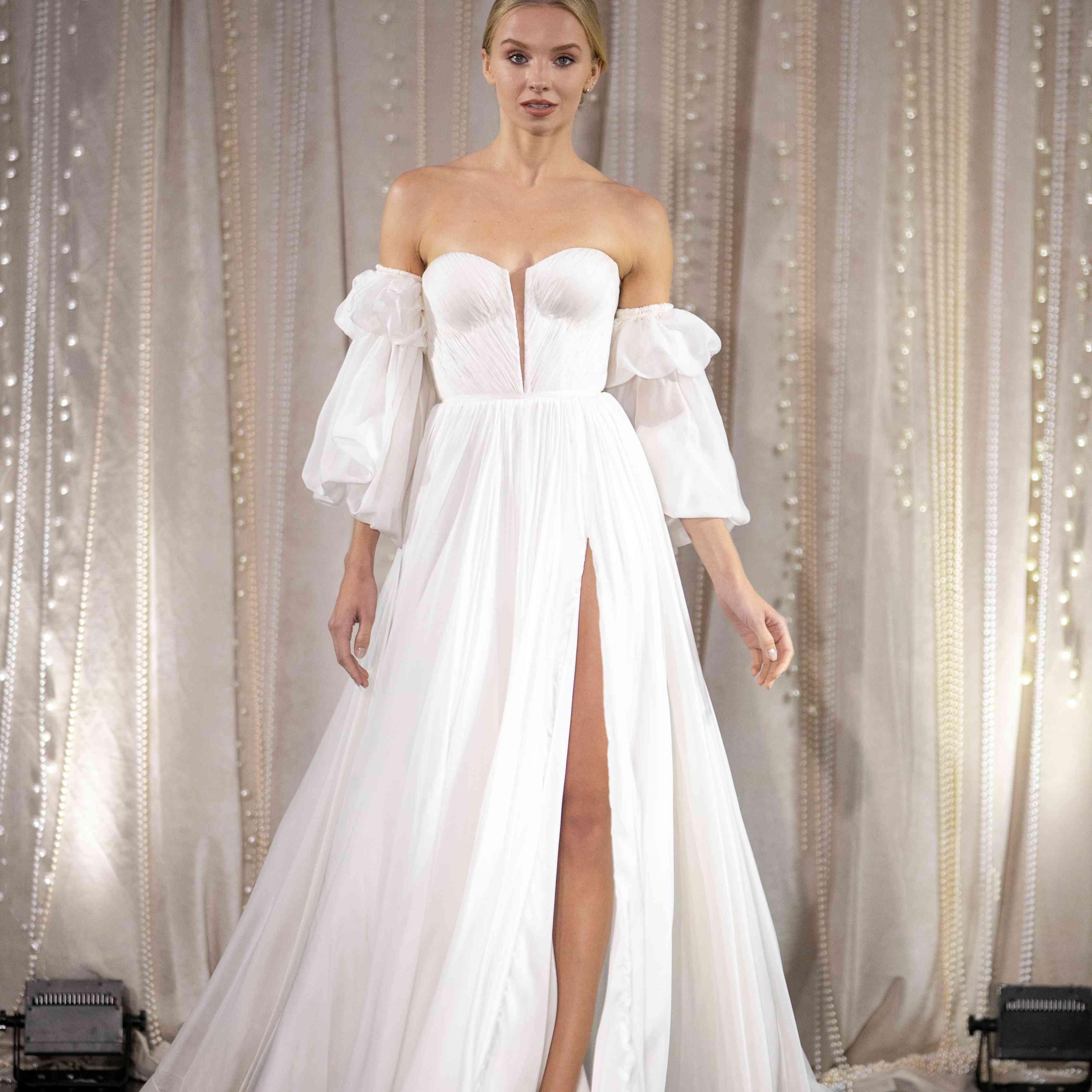 Model in off-the-shoulder A-line wedding dress
