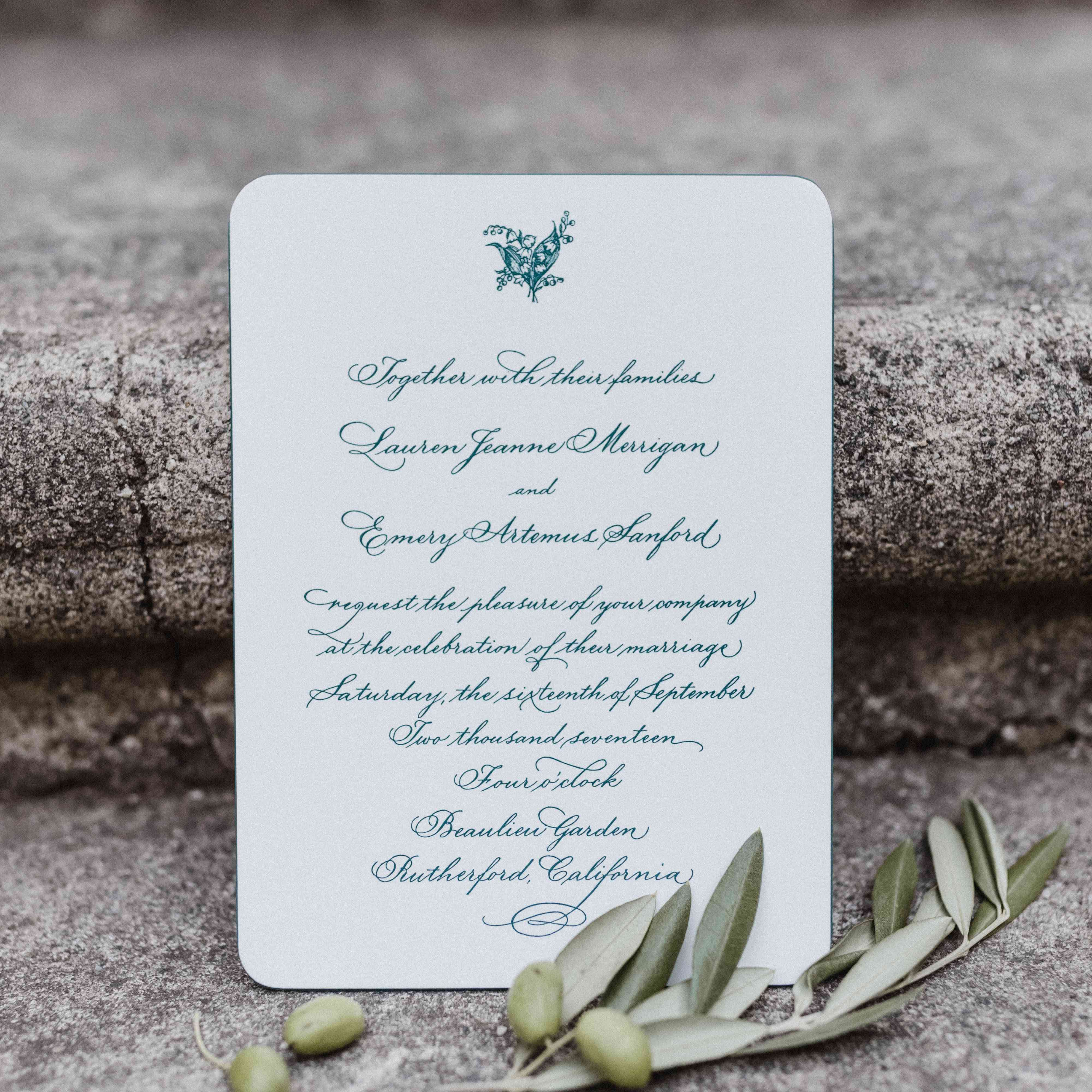 <p>green and white invitations</p>
