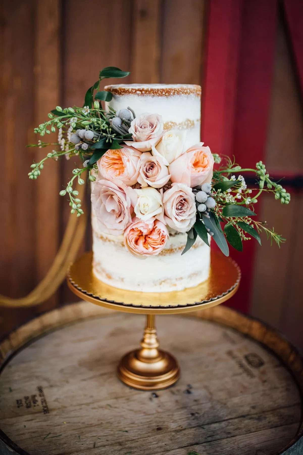 cake on display on a wine barrel