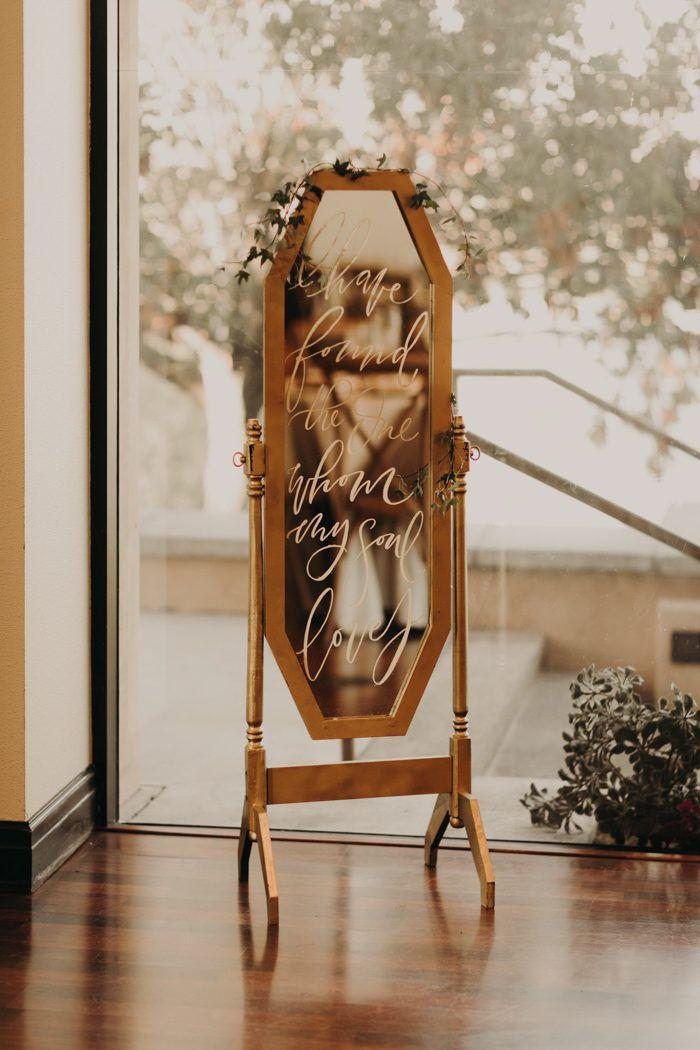 Calligraphy on mirror wedding sign.