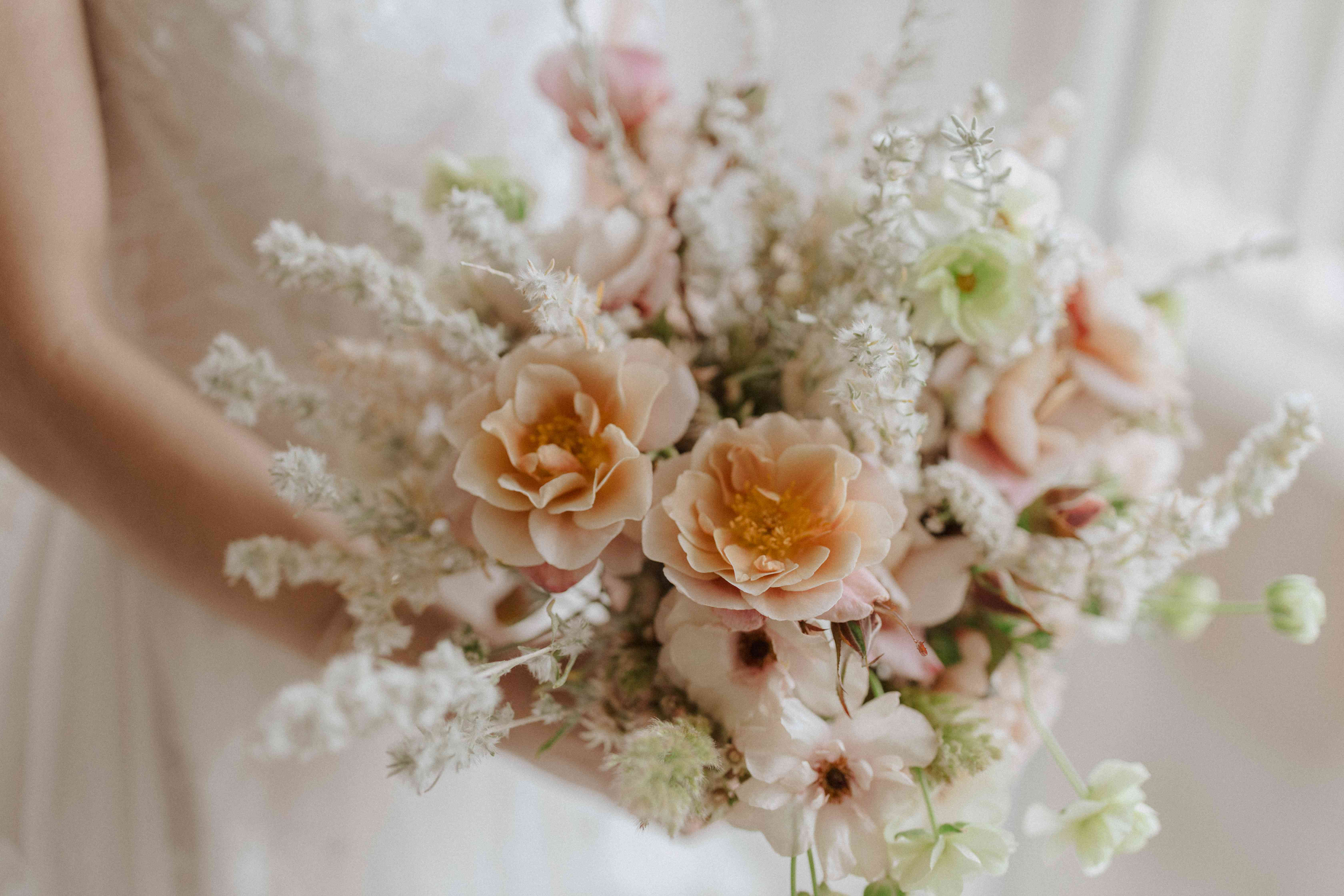 Bouquet of peach, pink, and white flowers