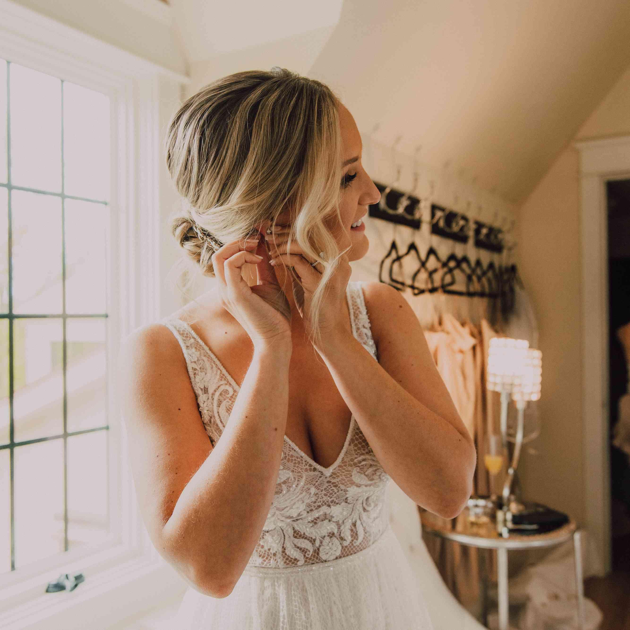 bride fixing earrings