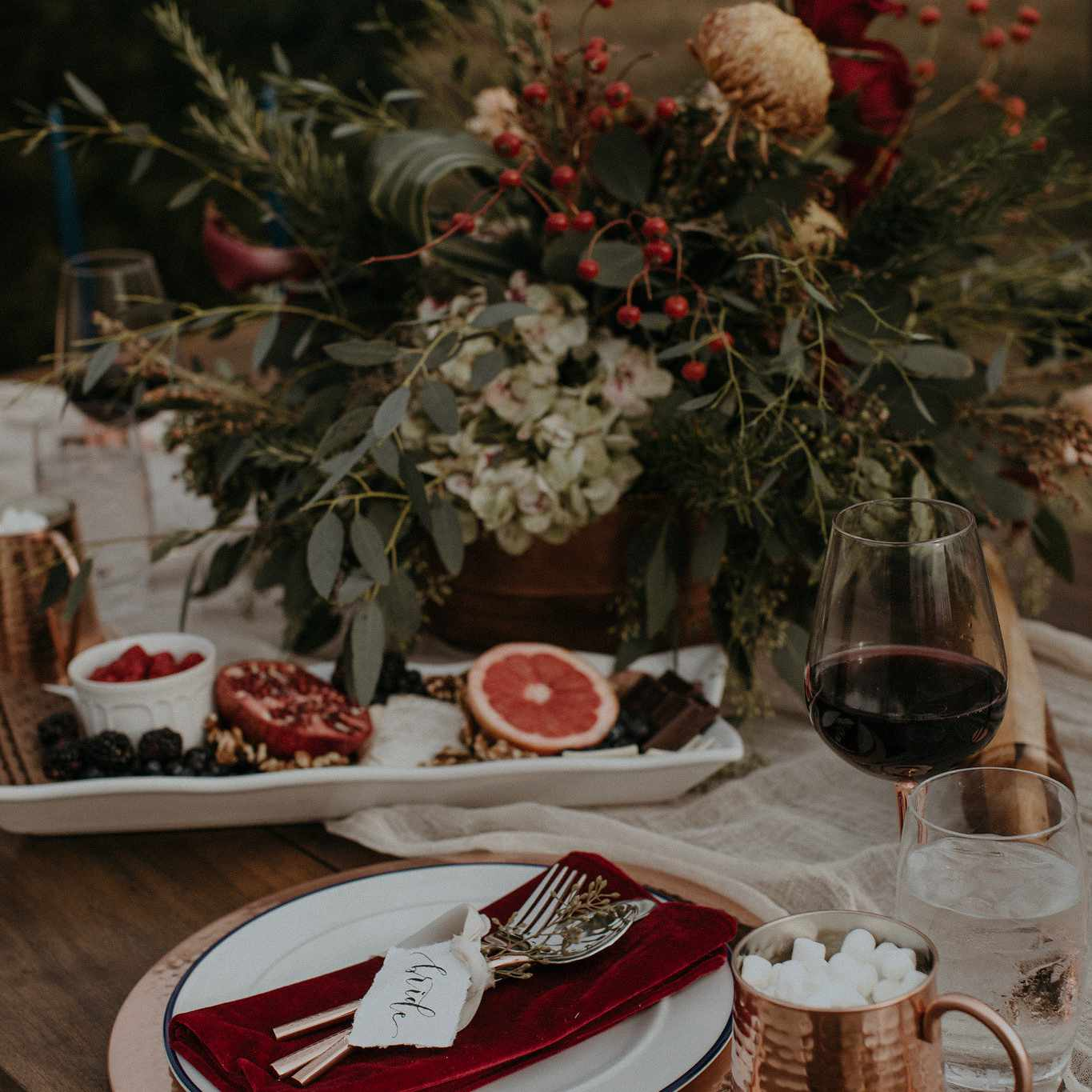 Winter wedding table setting with hot cocoa in a copper mug