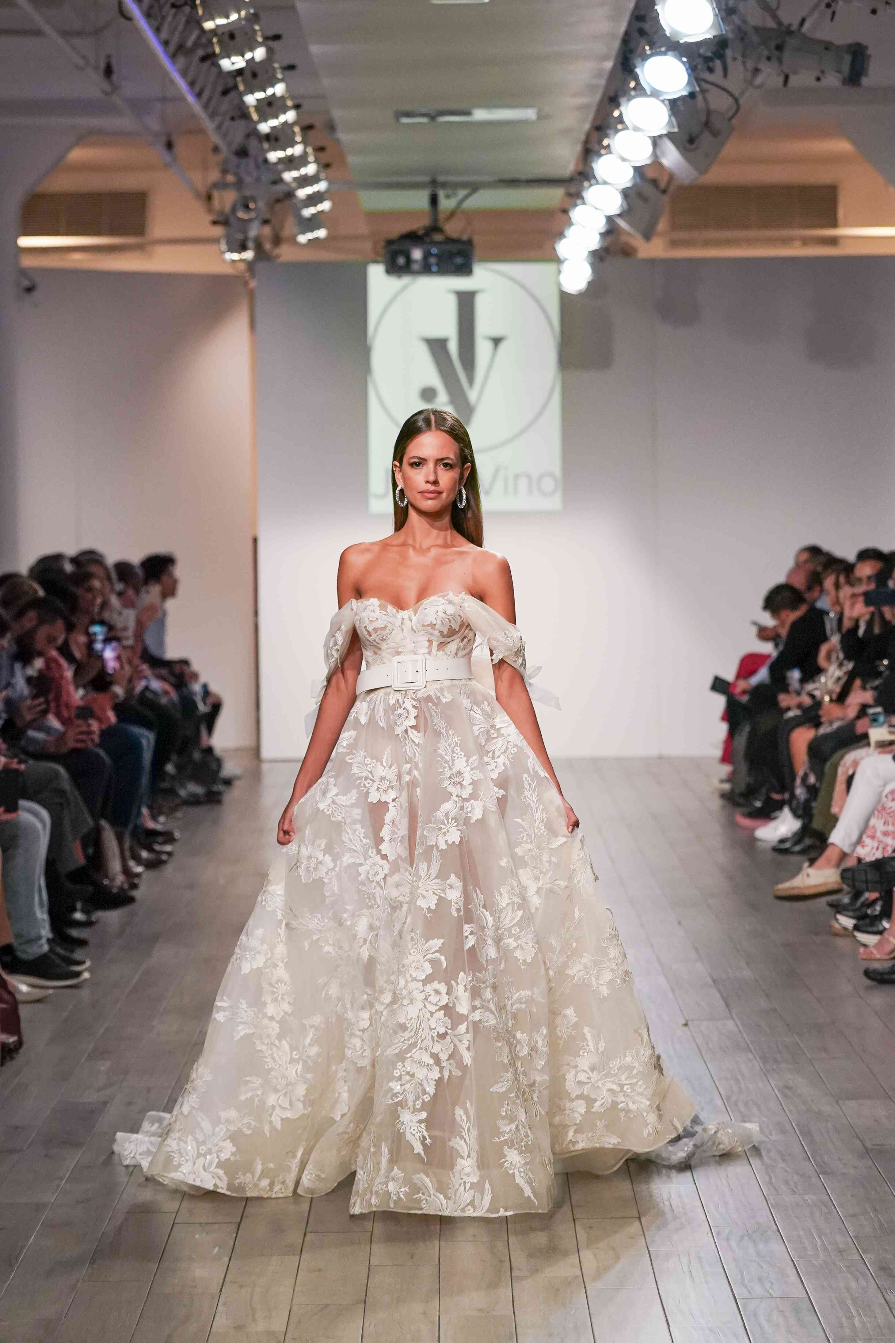 Model in off-the-shoulder organza wedding ball gown