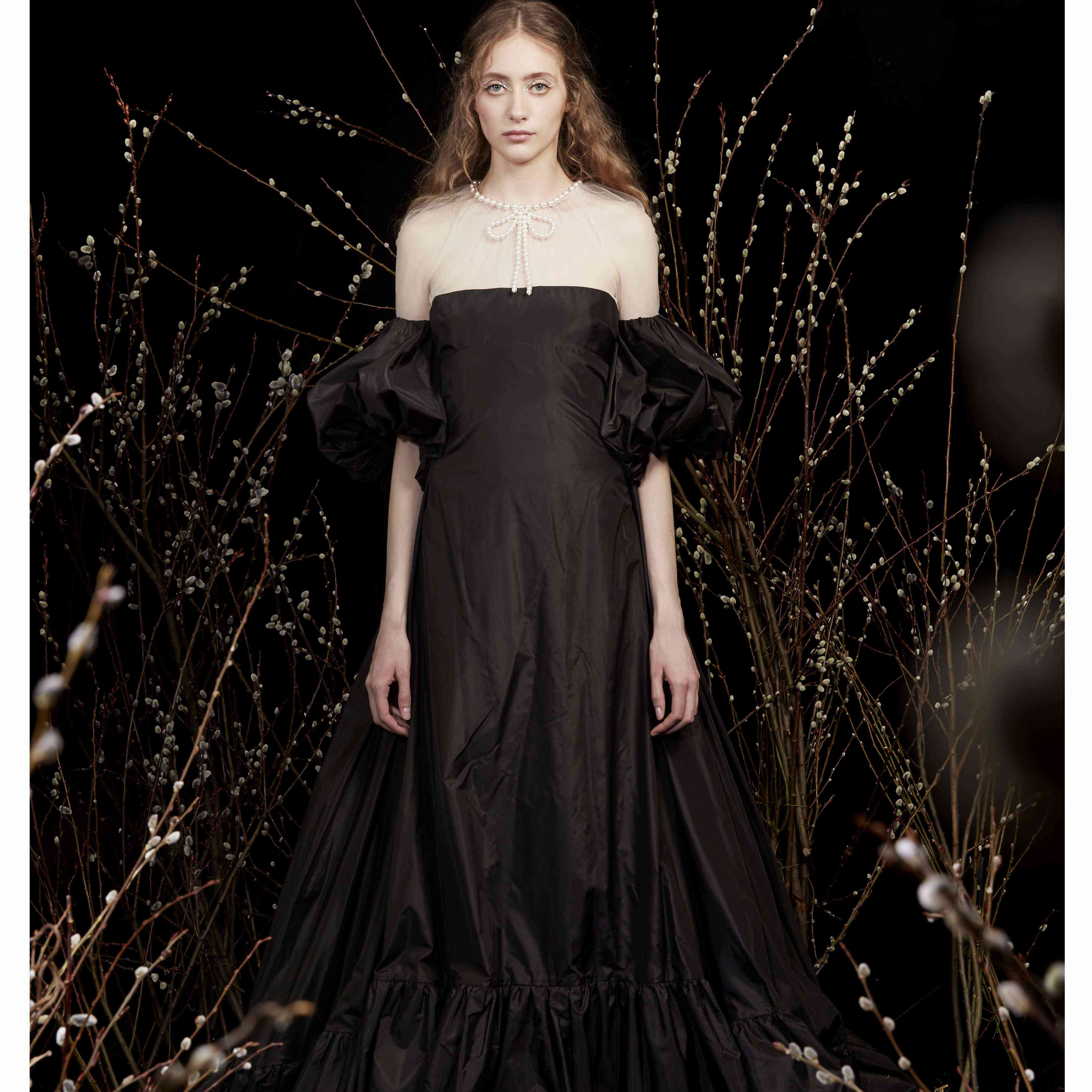 Model in black wedding dress with puff sleeves
