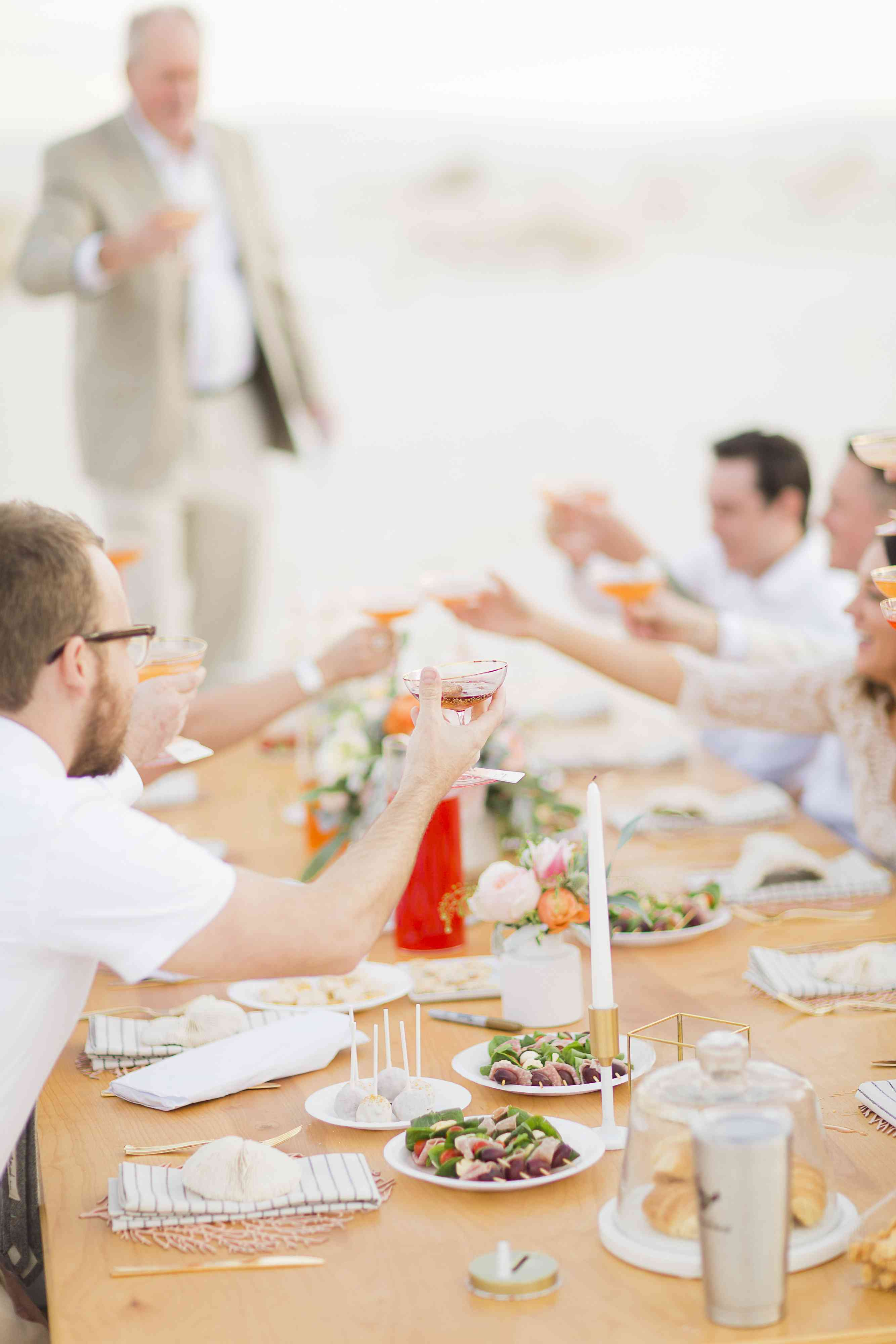 Guests Cheers With Champagne Coups