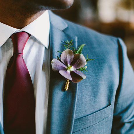 A purple clematis boutonniere created by Sebesta Design