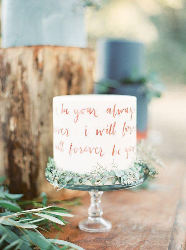 Wedding cake with calligraphy decoration.