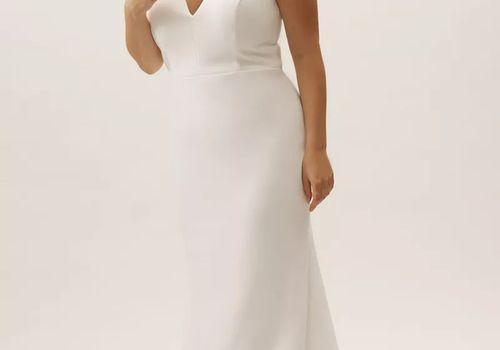 Bride posing in wedding gown