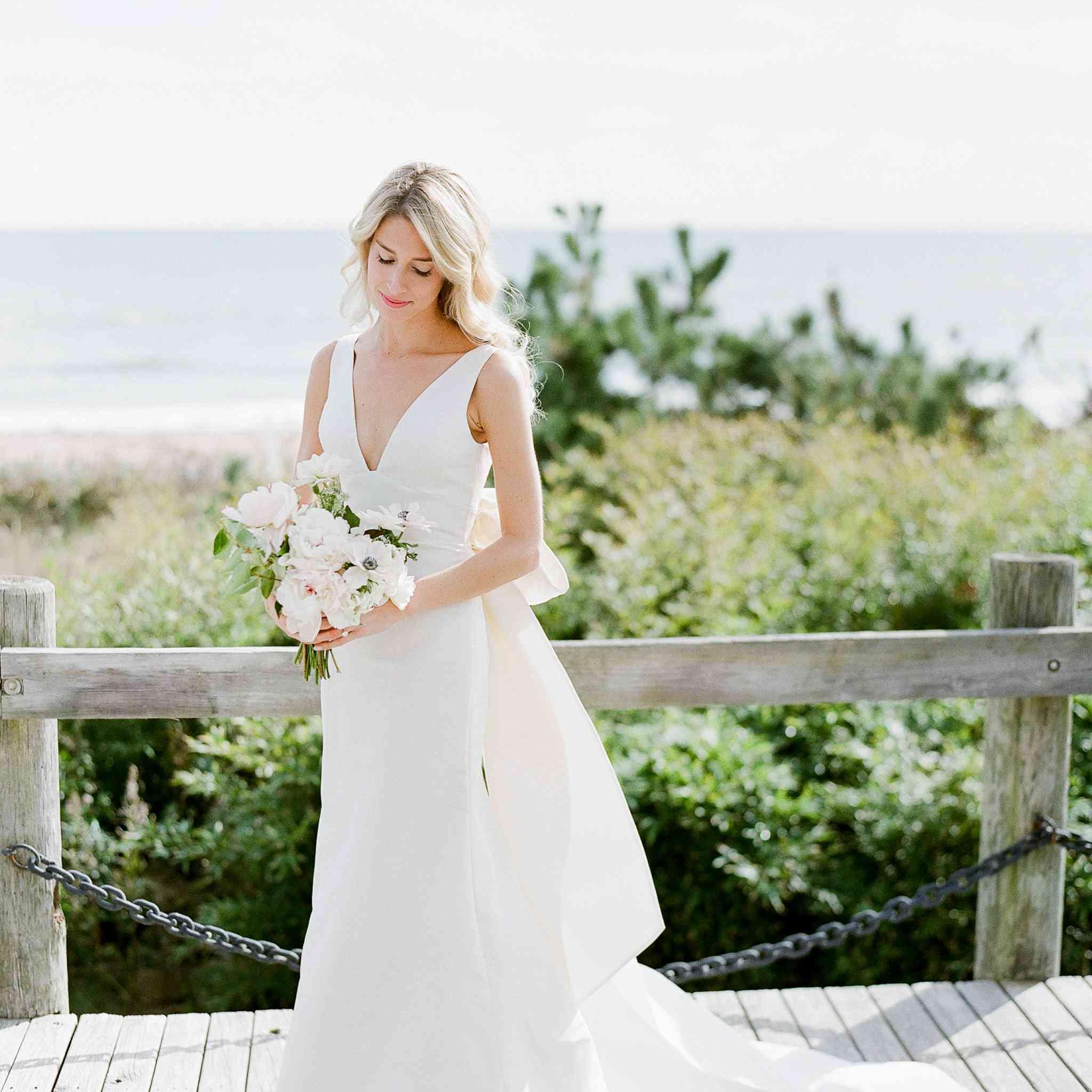 <p>bride trumpet wedding dress on dock</p><br><br>