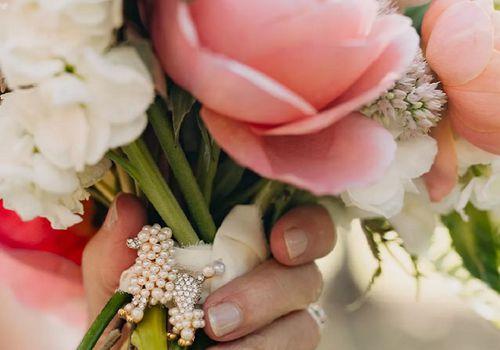 Vintage accessory on bridal bouquet