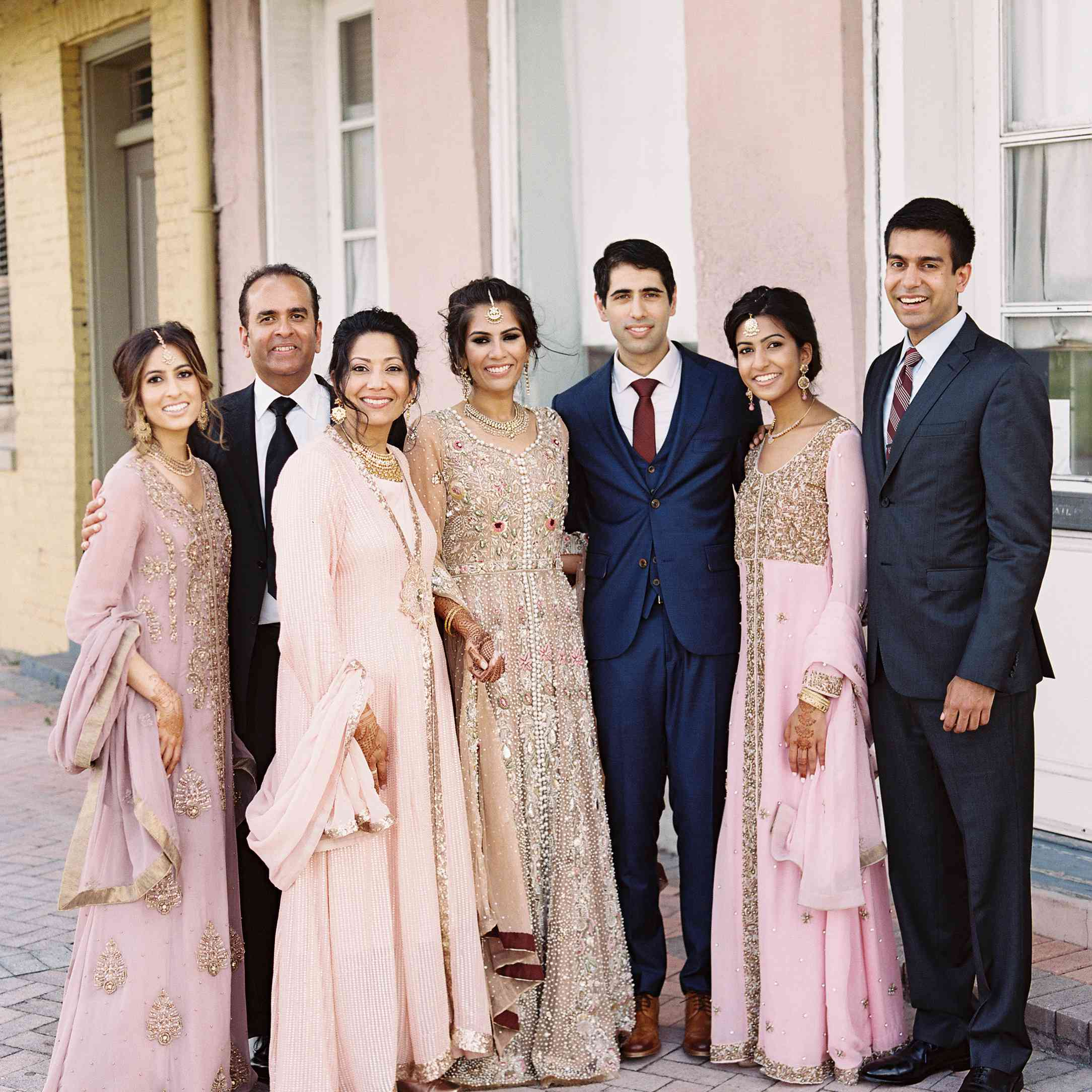 Indian bride and groom with wedding party