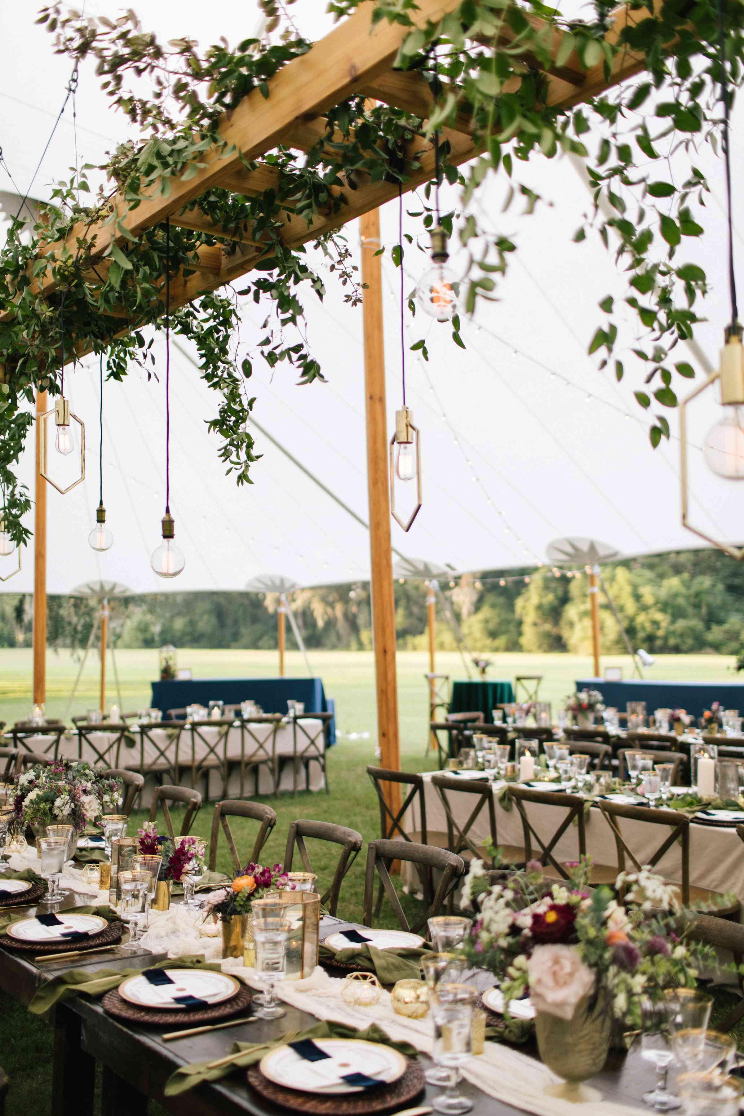 <p>Wedding Reception Greenery Overhang</p><br><br>