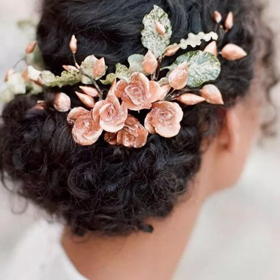 Floral hairpiece in gathered brown curls