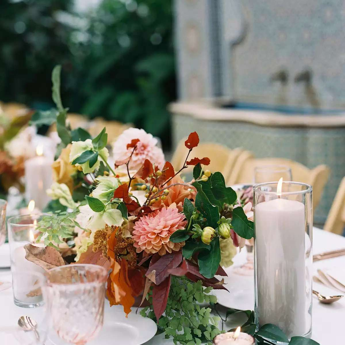 Autumnal arrangements with copper flatware and pillar candles