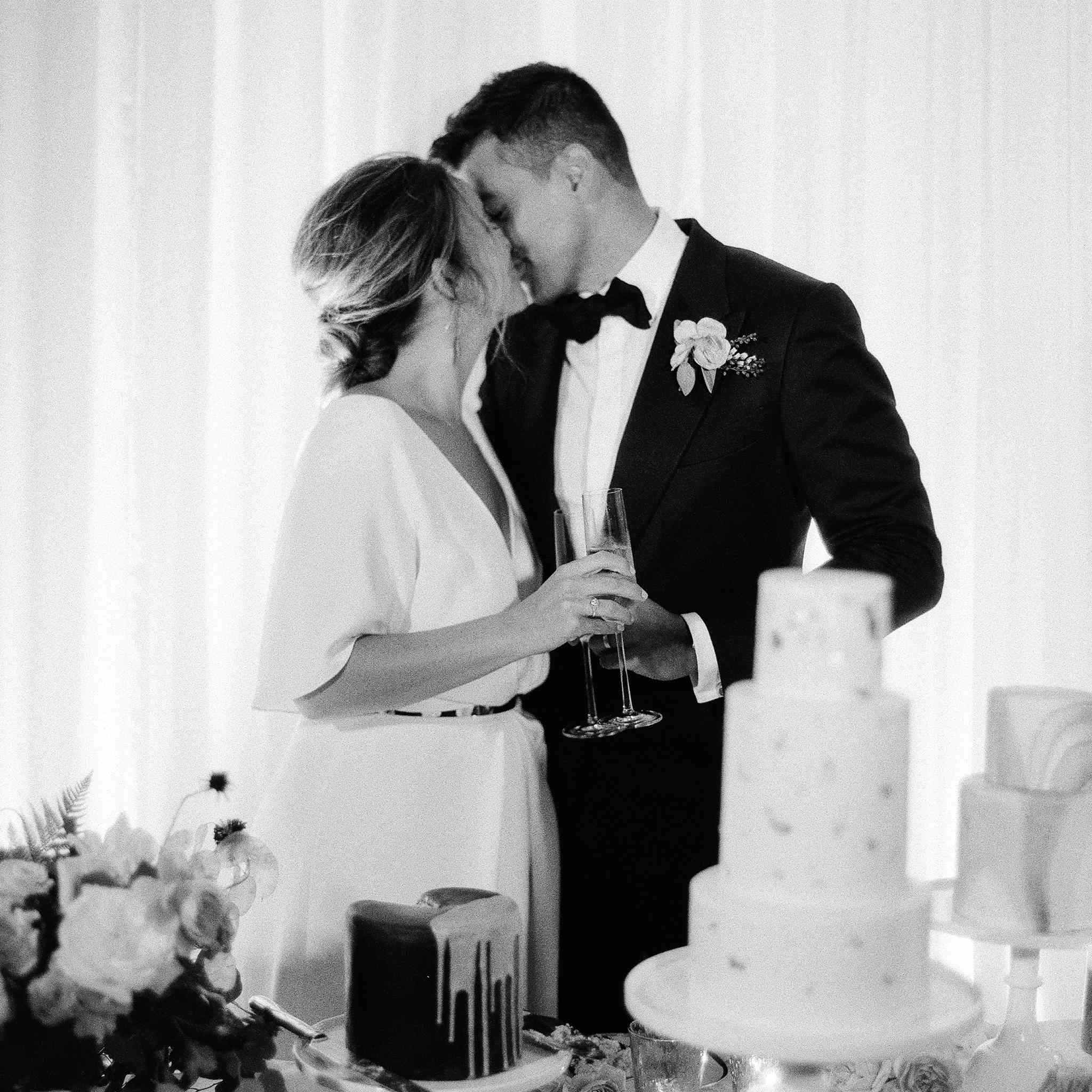 Bride and groom with cakes