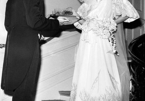 Fashion model wearing a wedding dress created by Dior in 1974