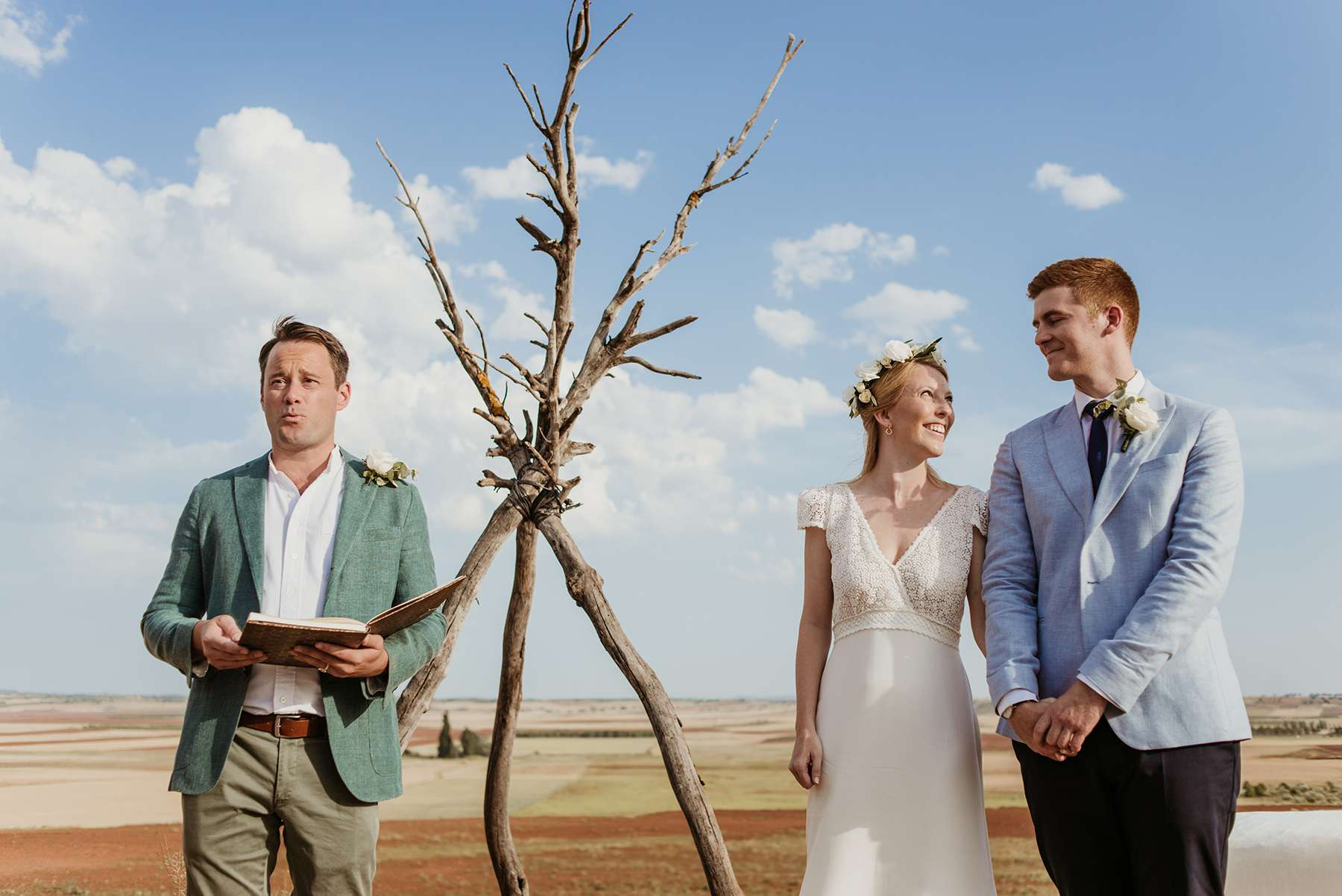 <p>Bride and groom with officiant</p><br><br>
