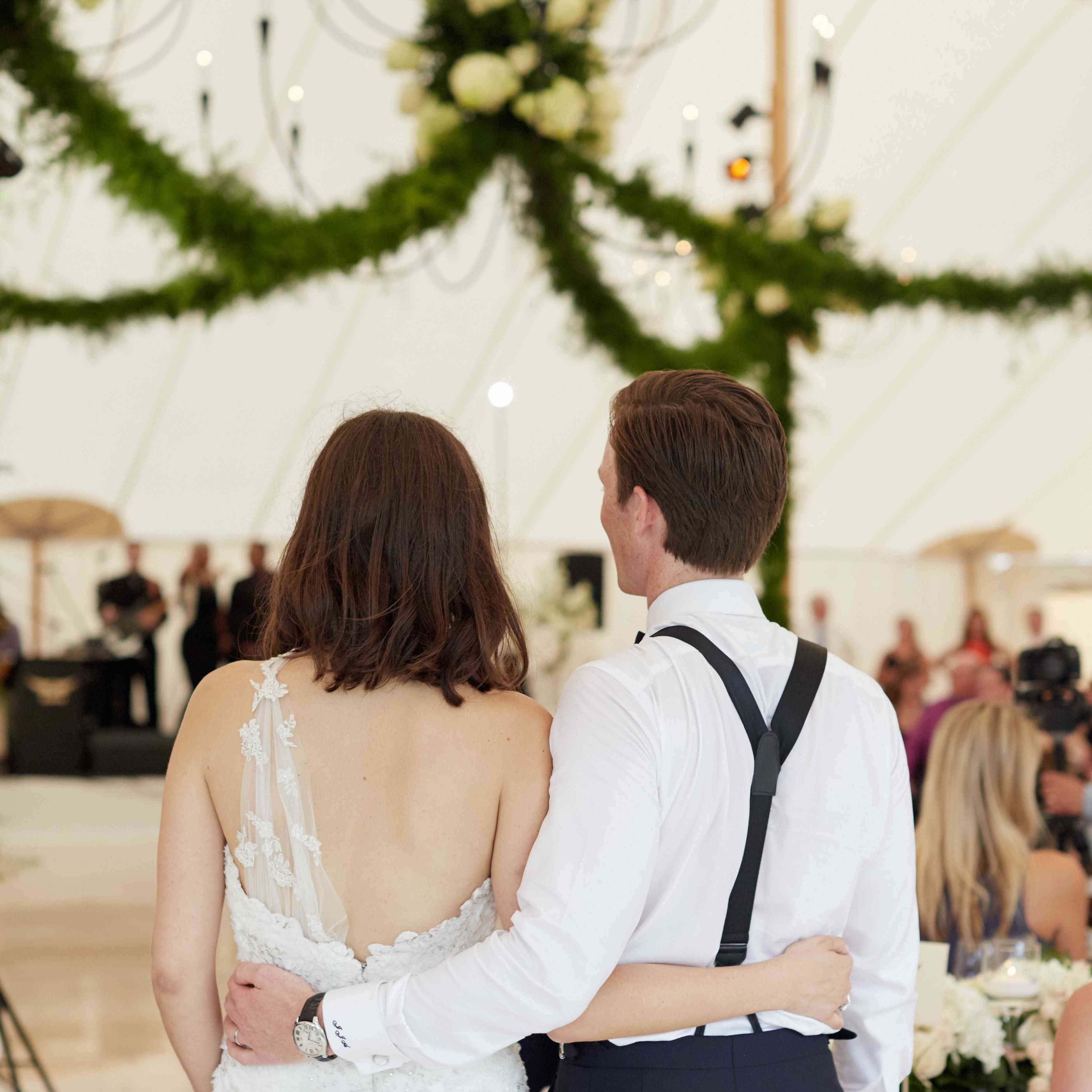 couple holding each other during wedding reception