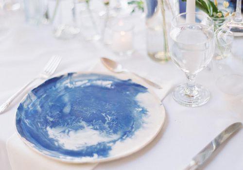 <p>handmade blue and white ceramic dinnerware</p>