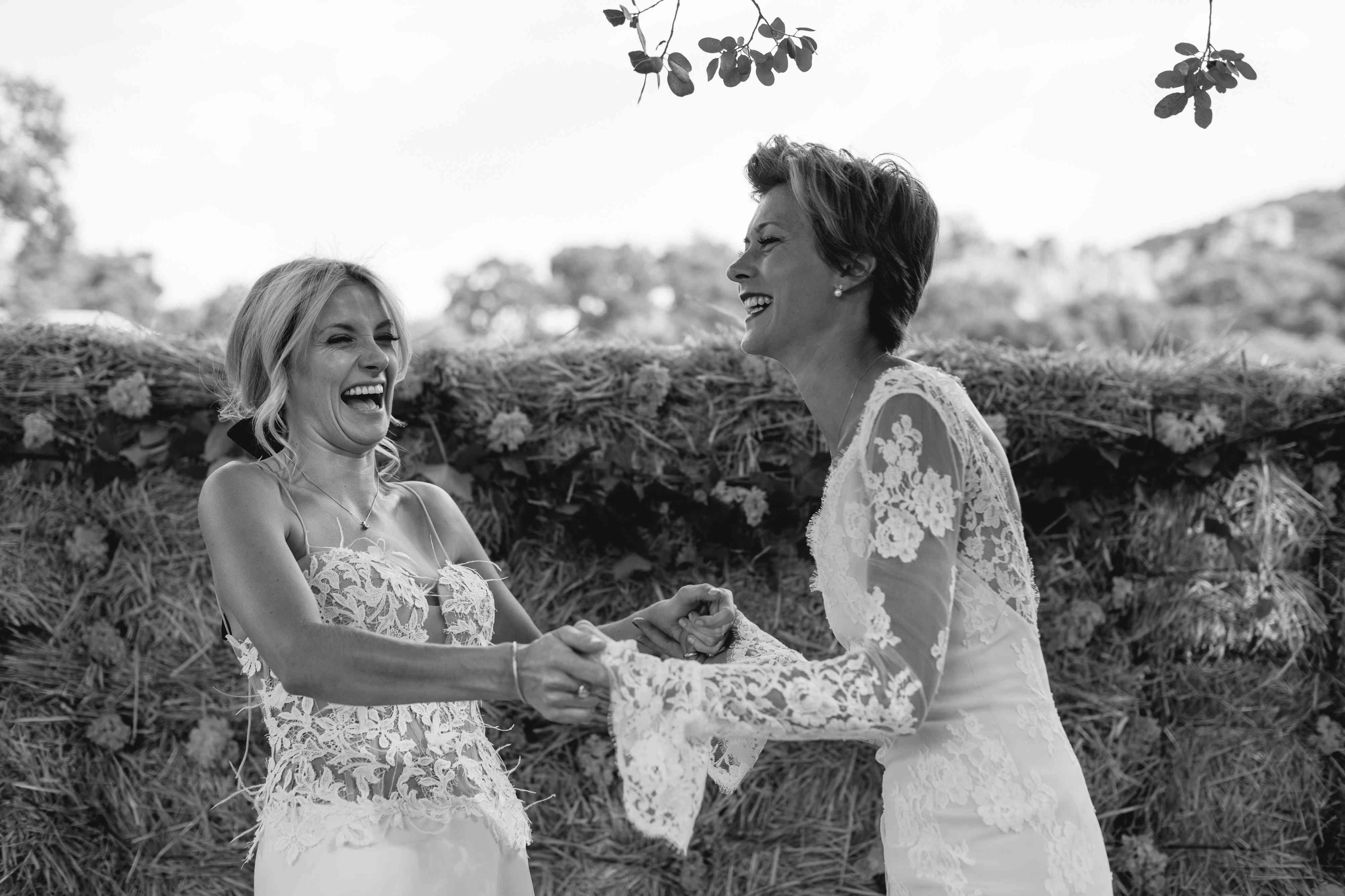 brides laughing at altar