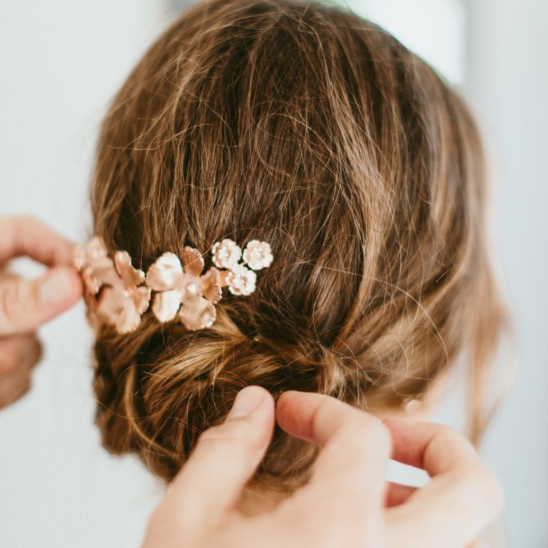 Rose gold floral pin in chignon