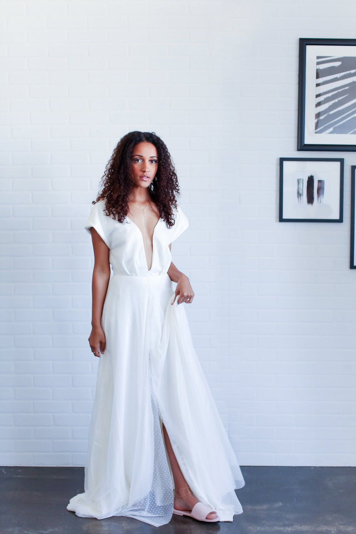 Neck-plunging flowy wedding dress in Swiss dot by Incandescent Bridal