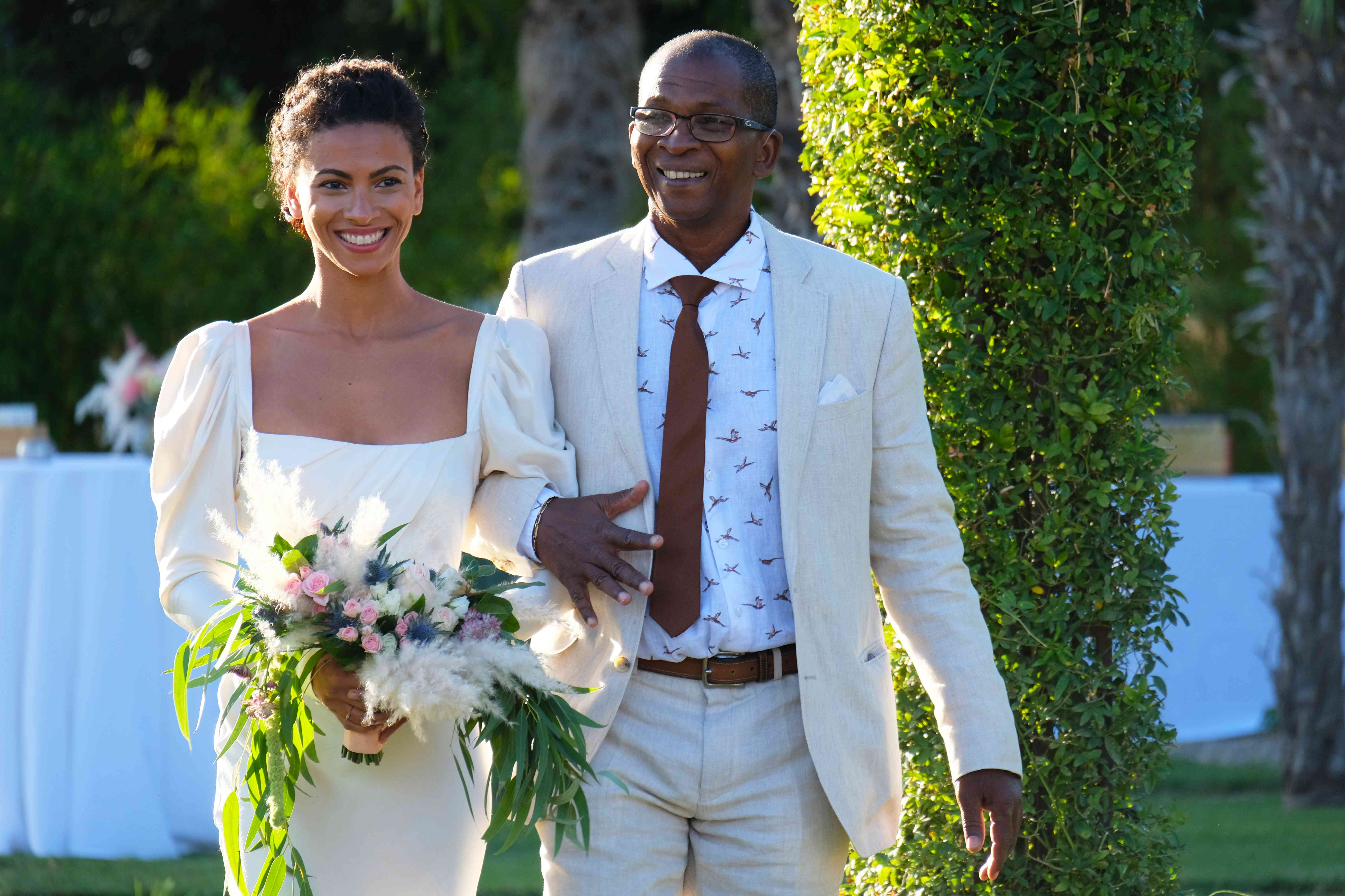 <p>bride walking with father</p><br><br>