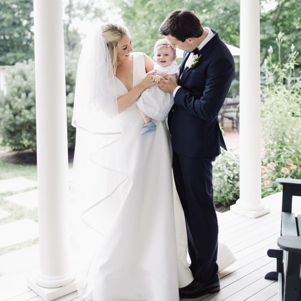 Bride and groom with baby