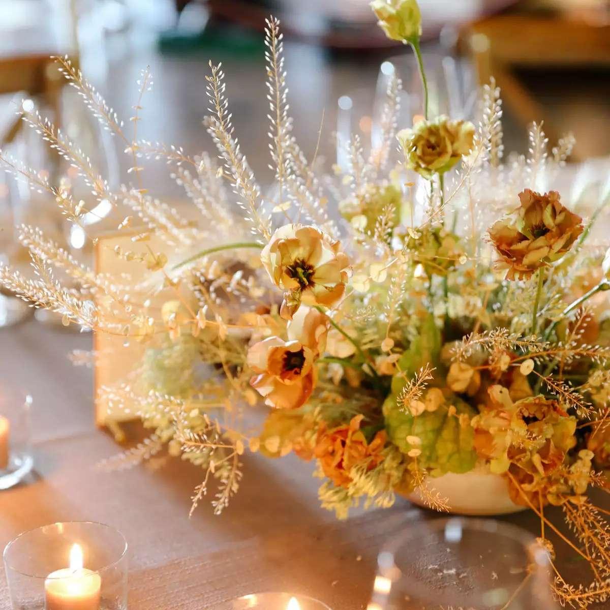 Nude votive candles and textured arrangements