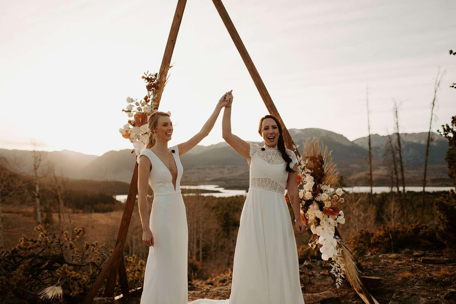 Brides celebrate at altar
