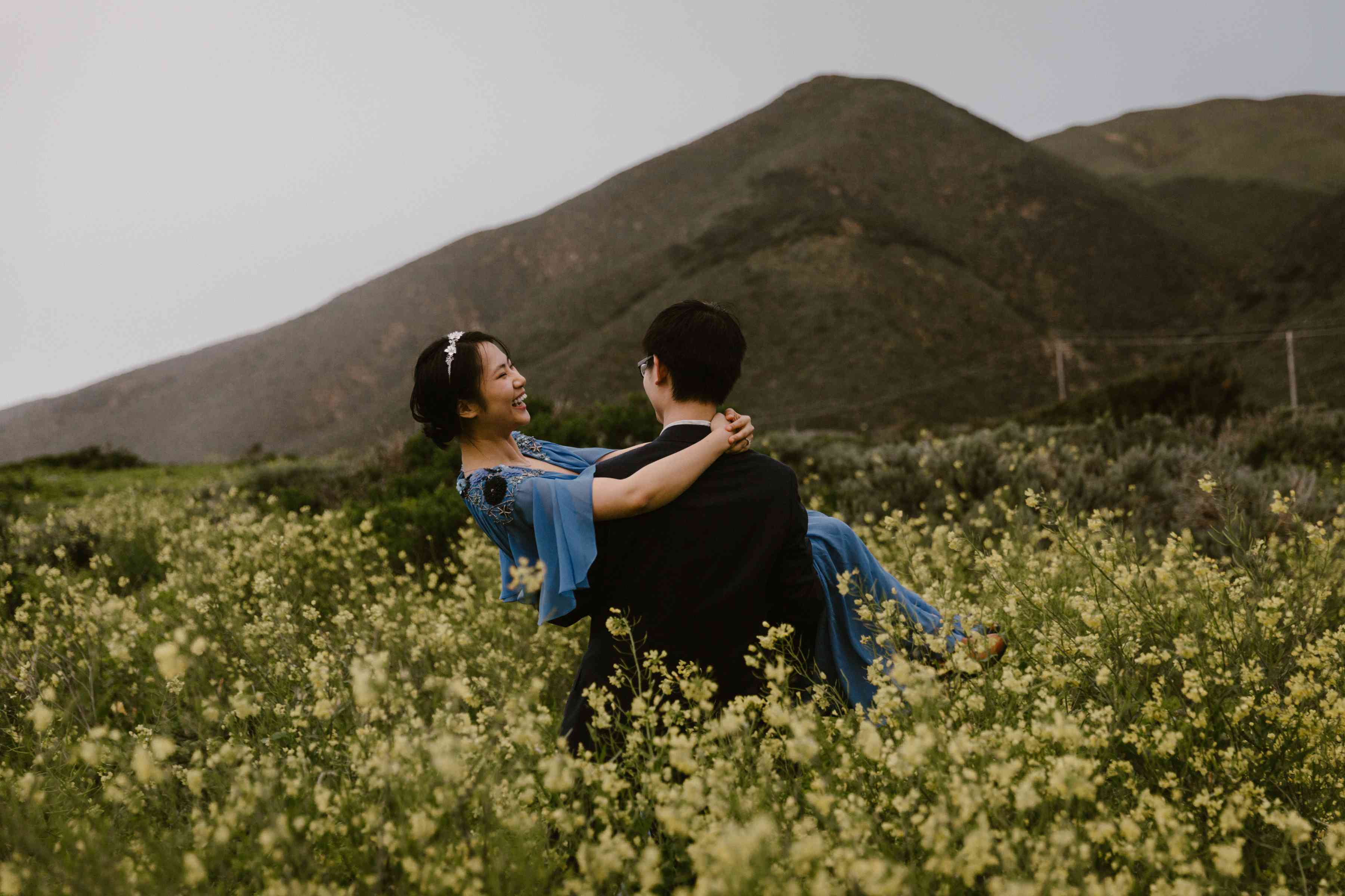 Couple in wild flower field in the mountains