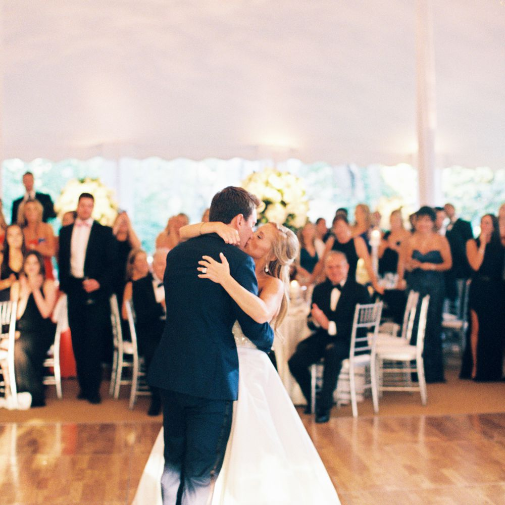 Newlyweds kissing during first dance