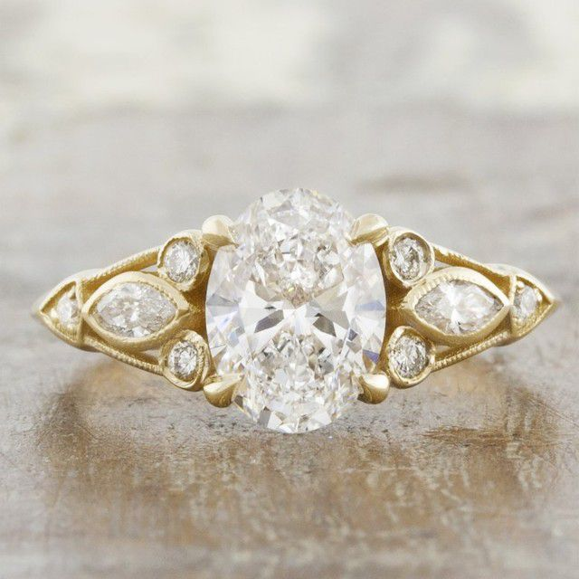 cluster ring with oval diamond
